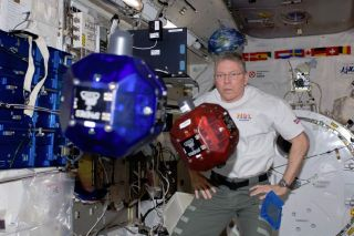 Mike Fossum SPHERES on ISS