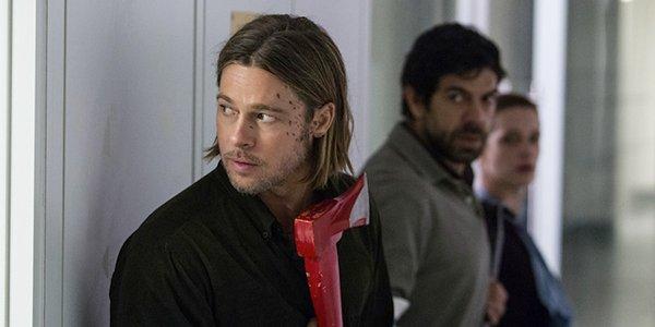 Brad Pitt's Gerry Lane looking cautiously around a corner in World War Z