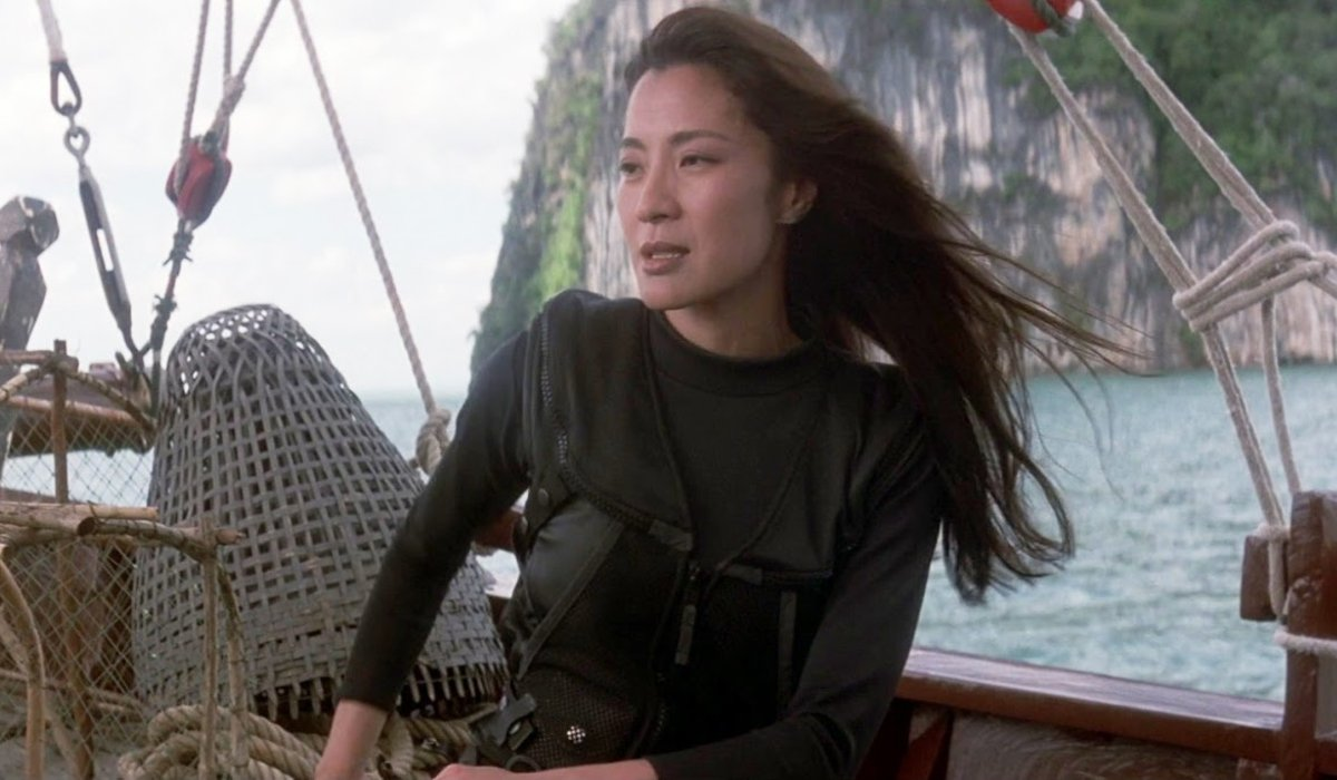 Michelle Yeoh readies her weapons on a boat in Tomorrow Never Dies
