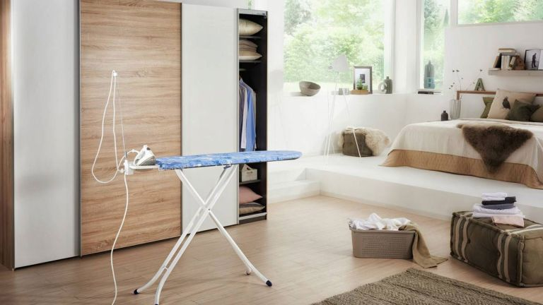The best ironing boards: Leifheit ironing board in bedroom