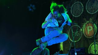 Eddie Vedder of Pearl Jam perform during their 'Backspacer' tour at Gibson Amphitheatre on September 30, 2009