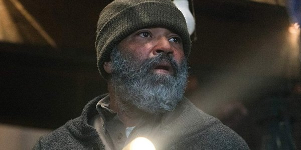 Jeffrey Wright holding a flashlight Russell Core Hold the Dark
