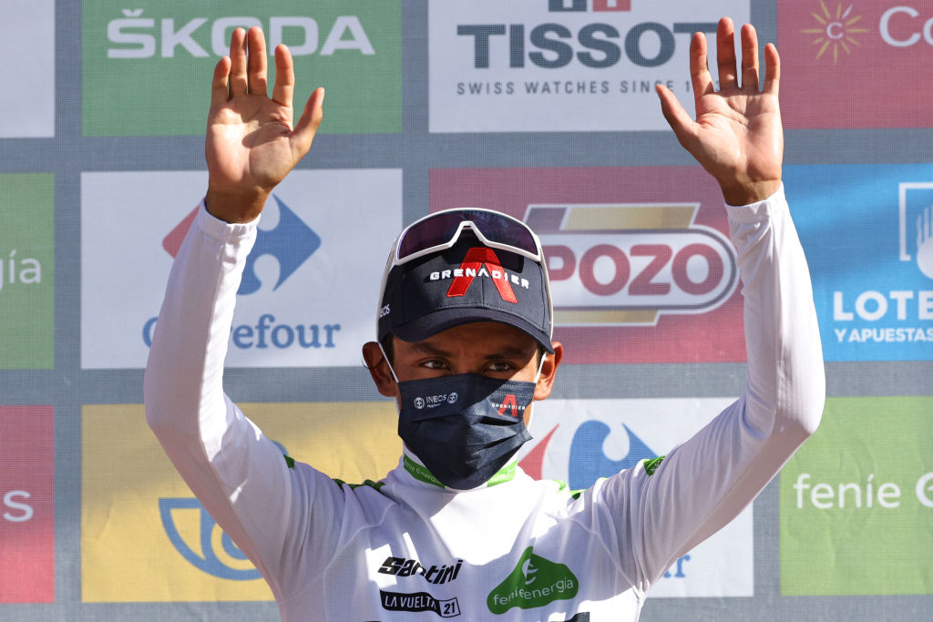 Team Ineos Colombian rider Egan Bernal celebrates on the podium retaining the Best Youngs white jersey after the 7th stage of the 2021 La Vuelta cycling tour of Spain a 152 km race from Gandia to Balcon de Alicante in Tibi on August 20 2021 Photo by JOSE JORDAN AFP Photo by JOSE JORDANAFP via Getty Images
