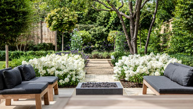 large garden ideas: patio space with brick and gravel pathway