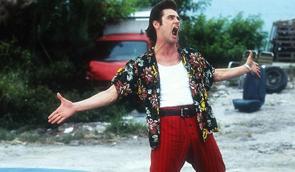 Ace Ventura: Pet Detective Jim Carrey makes some noise in the middle of a junkyard
