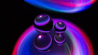 Abstract spheres represent the three-body problem in physics.