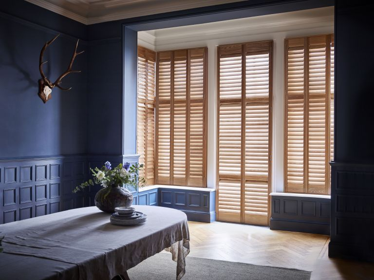 Shutters at French doors in living space by Shutterly Fabulous