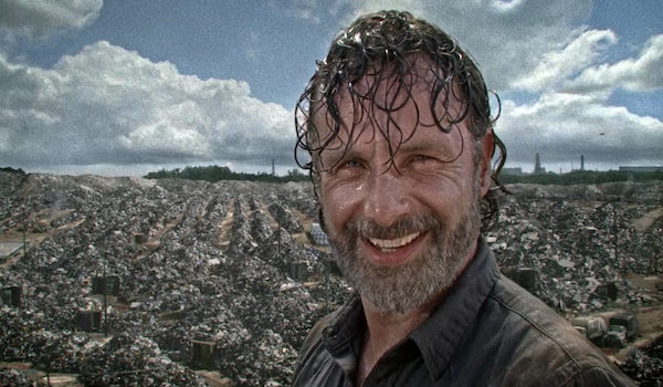 rick smiling with helicopter in background