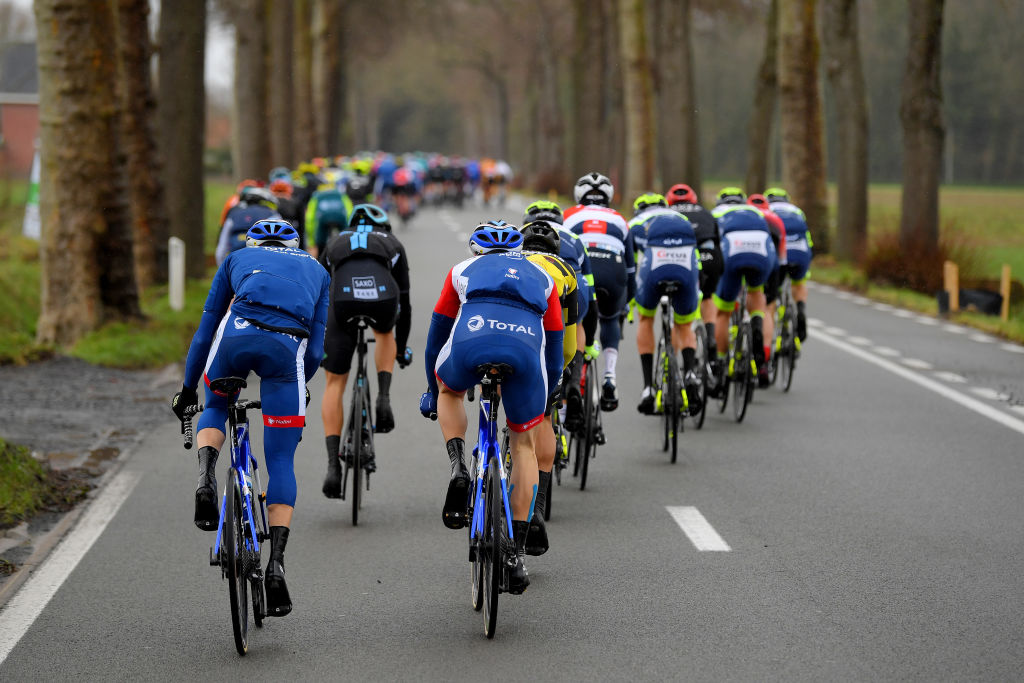 NOKERE BELGIUM MARCH 17 The peloton during the 75th Nokere Koerse Danilith Classic 2021 Mens Elite a 1955km race from Deinze to Nokere Detail view Landscape NokereKoerse on March 17 2021 in Nokere Belgium Photo by Luc ClaessenGetty Images