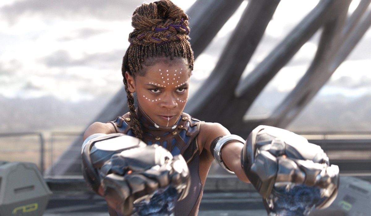 Black Panther Shuri aims her gauntlets at the threat
