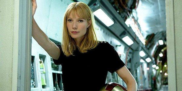 Pepper Potts with Iron Man's helmet under her arm