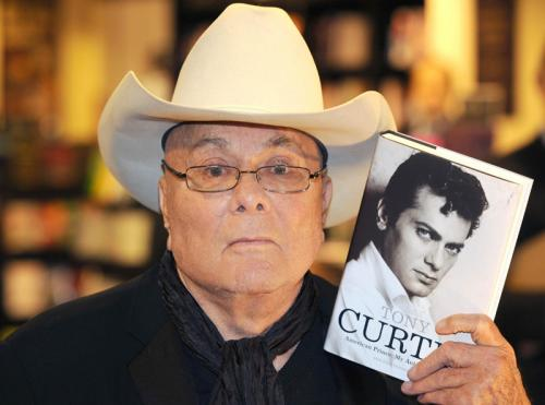 Hollywood legend Tony Curtis with a copy of his autobiography American Prince