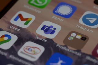 an iphone screen showing icons for gmail, teams, signal and other apps