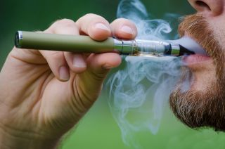 A person smoking an e-cigarette.