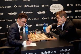 Magnus Carlsen, the reigning World Chess Champion (right) and Fabiano Caruana, U.S. Challenger during Round 1 of the FIDE World Chess Championship Match on Nov. 9, 2018 in London.