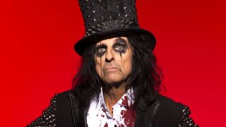 Portrait of Alice Cooper in studded suit and top hat