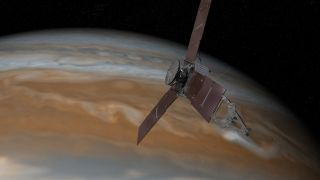Artist concept of Juno passing over Jupiter