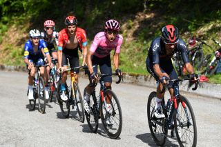 ALPE DI MERA VALSESIA ITALY MAY 28 Daniel Felipe Martinez Poveda of Colombia and Team INEOS Grenadiers Egan Arley Bernal Gomez of Colombia and Team INEOS Grenadiers Pink Leader Jersey Damiano Caruso of Italy and Team Bahrain Victorious Joao Almeida of Portugal and Team Deceuninck QuickStep Hugh Carthy of United Kingdom and Team EF Education Nippo in breakaway during the 104th Giro dItalia 2021 Stage 19 a 166km stage from Abbiategrasso to Alpe di Mera Valsesia 1531m Stage modified due to the tragic events on May the 23rd 2021 that involved the Mottarone Cableway UCIworldtour girodiitalia Giro on May 28 2021 in Alpe di Mera Valsesia Italy Photo by Tim de WaeleGetty Images