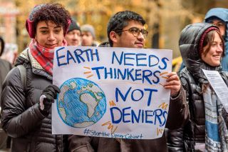 Marchers at a protest show their support for science.