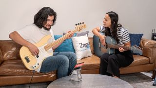 Zappos employees play Fender guitars