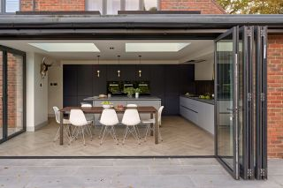 Open plan kitchen featuring bifold doors