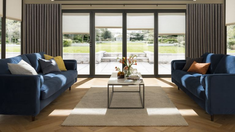 Blue sofas in conservatory area by Thomas Sanderson