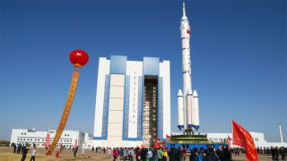 The Chinese Long March 2F rocket due to carry the Shenzhou 8 spacecraft to orbit in November 2011 rolls to the launch pad in Mongolia.