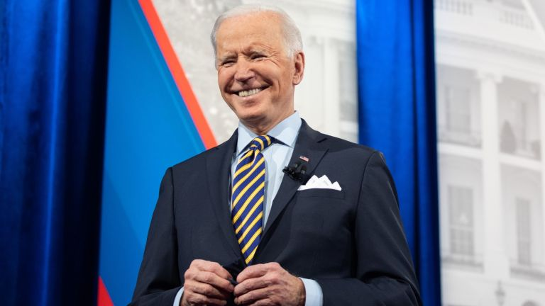 US President Joe Biden holds a face mask as he participates in a CNN town hall at the Pabst Theater in Milwaukee, Wisconsin, February 16, 2021