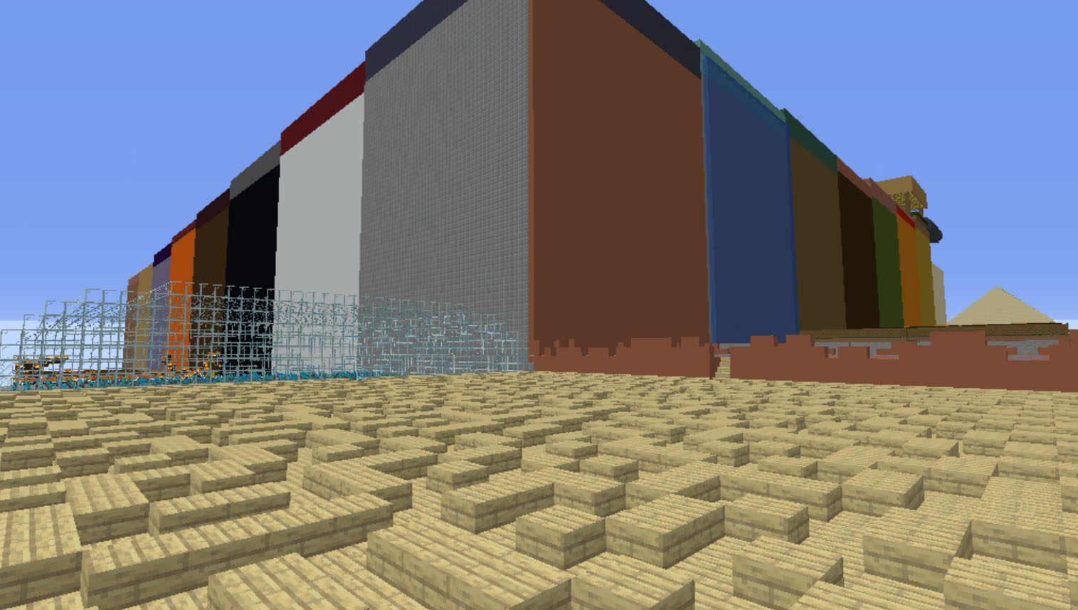 A huge square builing overlooking a wooden maze in Minecraft
