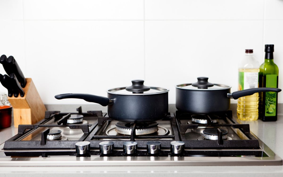 How to clean a stovetop thoroughly to remove burnt-on food
