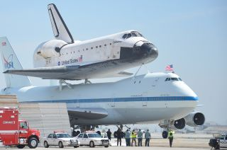 Space shuttle Endeavour and its Shuttle Carrier Aircraft receive a warm welcome at Los Angeles International Airport on Sept. 21, 2012.