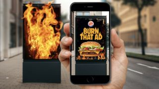 Burger King app next to a flaming poster