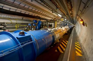 The LHC tunnel where particles accelerate.