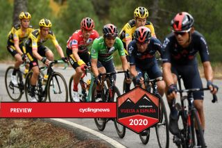 Primoz Roglic and Richard Carapaz ride in peloton on stage 16 of Vuelta a España