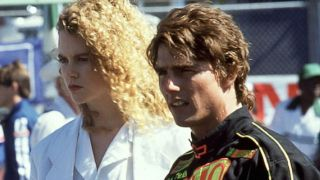 Nicole Kidman and Tom Cruise standing on the race track in Days of Thunder