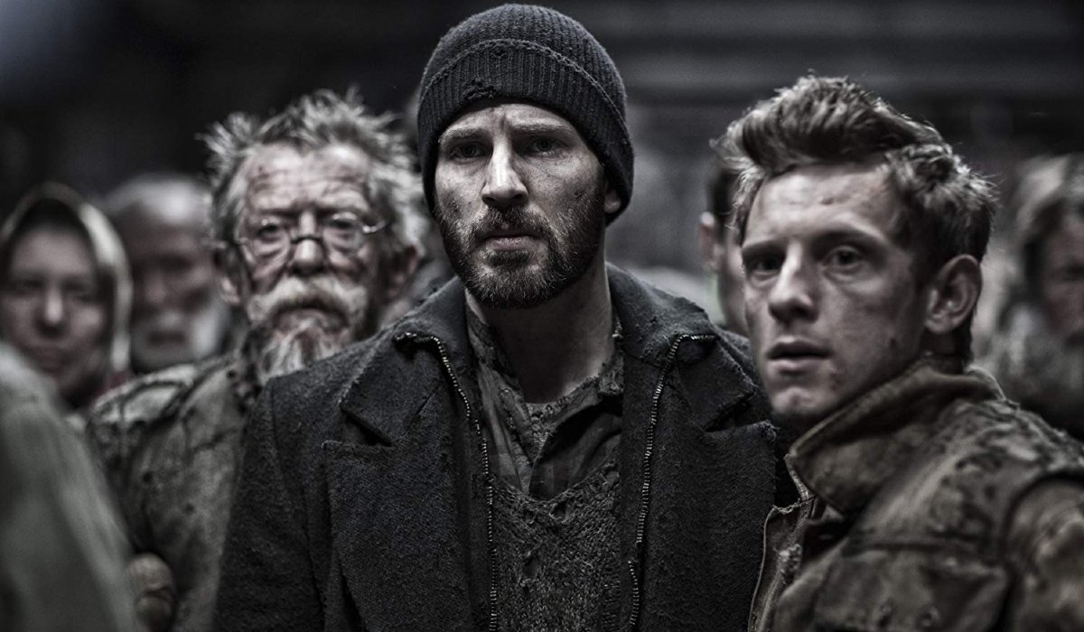 Snowpiercer John Hurt, Chris Evans, and Jamie Bell looking worried on board the train