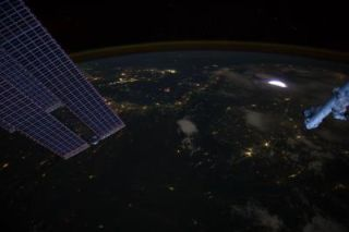 A sprite glows red (inset) in this image captured by astronauts on the International Space Station on April 30, 2012.