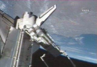 Astronauts Begin Space Construction Job