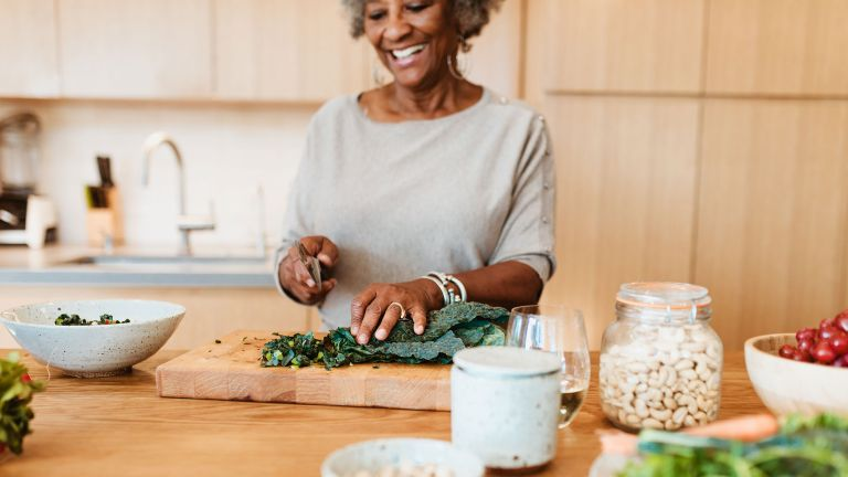 Woman cooking with immunity-boosting foods