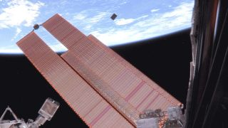 The ASTERIA cubesat (top center) deploys from the International Space Station on Nov. 20, 2017.