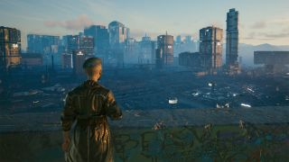 An image taken within Cyberpunk 2077's photo mode of the Night City skyline with a character stood in the lower left