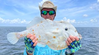 Angler Tom Bosworth holds the tortilla-like fish he caught before throwing it back into Tampa Bay.