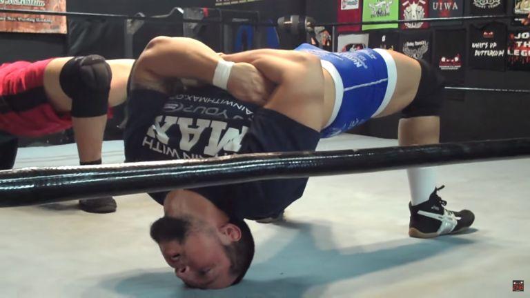 wrestler neck bridge mike tyson anthony joshua bodyweight exercise