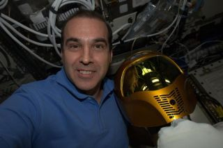 "NASA astronaut Rick Mastracchio posted this selfie snapshot of himself and NASA's Robonaut 2 robot on the International Space Station while taking part in the ""Live From Space"" broadcast on the National Geographic Channel on March 14, 2014."