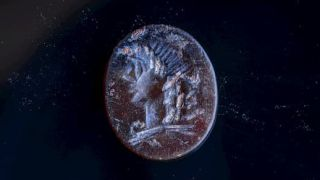 The detailed carving of Apollo is smaller than a dime.