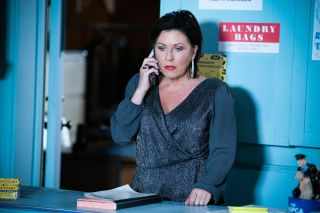 Kat Slater takes a call in EastEnders