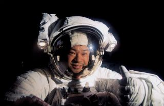 NASA astronaut Leroy Chiao gives a thumbs up signal during a spacewalk outside the International Space Station on Jan. 17, 1996.
