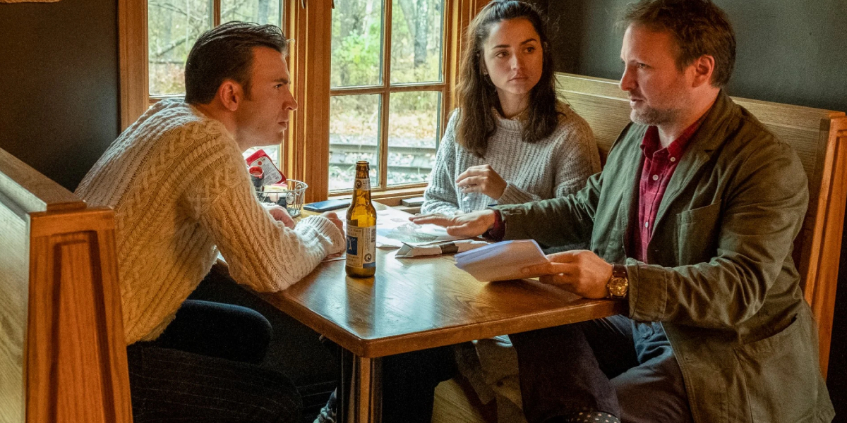 Rian Johnson directs Chris Evans and Ana de Armas on the set of Knives Out