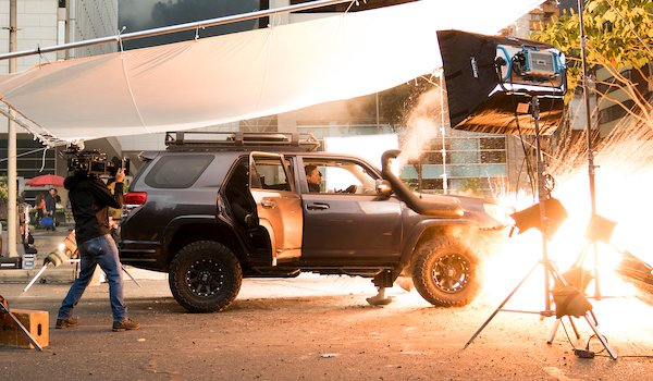 A car explodes on the set of Mile 22