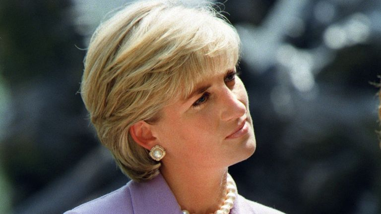 Diana, Princess of Wales, a key volunteer of the British Red Cross Landmine Campaign listens to speaker Ken Rutherford who was injured by a land mine in Somalia at ceremonies at Red Cross headquarters in Washington DC 17 June 1997